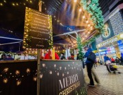 image of Croydon town centre and a sausage stand at Christmas