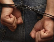 hands in hand cuffs